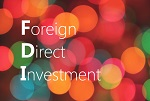 Foreign Direct Investment as text in blurred bubbles