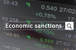 Economic Sanctions text on stock chart
